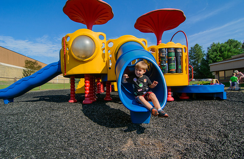 Boy on slide smiling