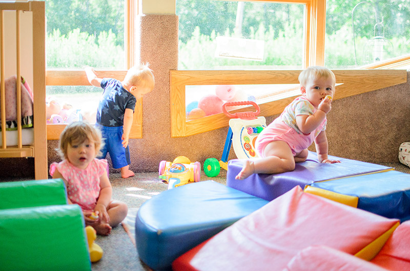 Toddlers playing inside