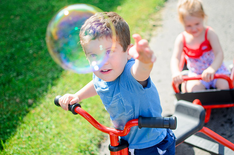 Boy popping bubble
