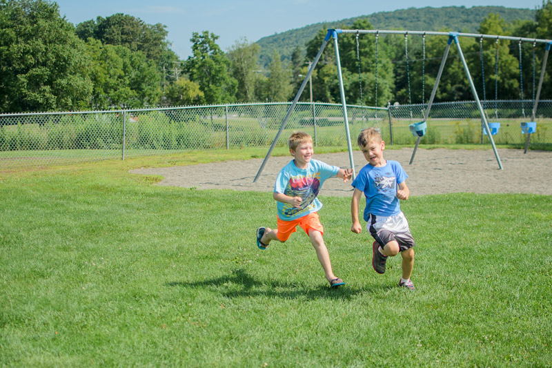 Boys running and playing outside