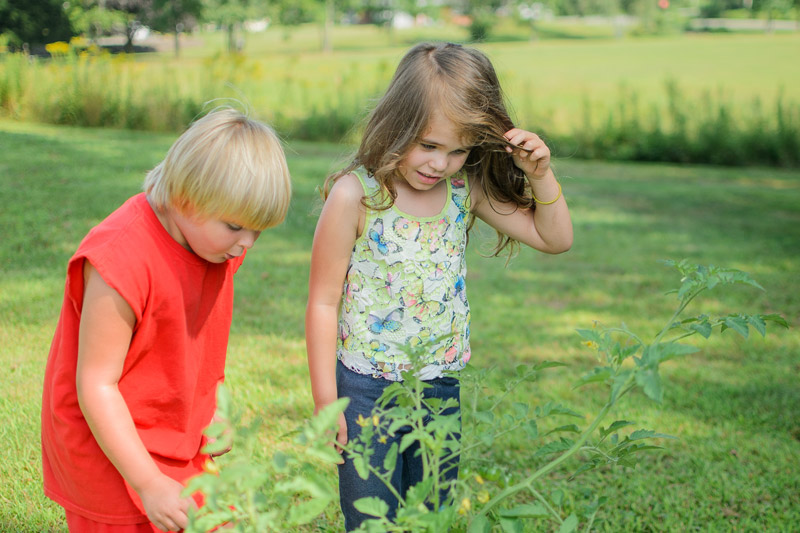 Two children learning outside