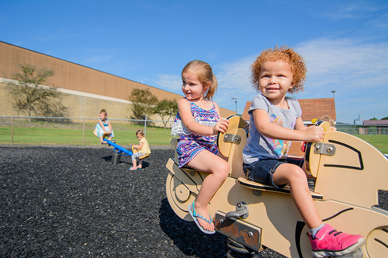Girls smiling on playground